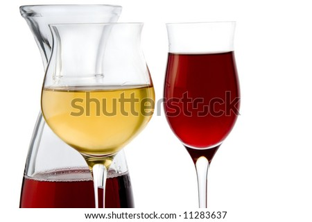 a jug and a glass of white and glass of red wine