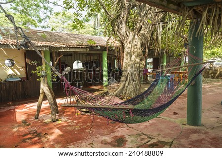 A Juice bar with a hammock in quiet Playa Garza Nosara, Costa Rica - stock photo