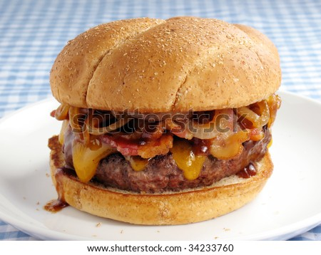 A juicy burger topped with cheddar cheese, bacon, barbecue sauce, and sauteed onions. Served on a toasted wheat bun.