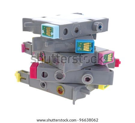 A jumbled stack of empty ink-jet printer cartridges on a white background. - stock photo