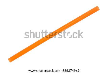 A jumbo sized orange drinking straw for smoothies and milkshakes isolated on a white background. - stock photo