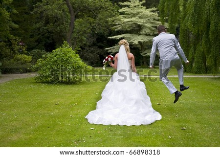a jumping groom with his beautiful bride