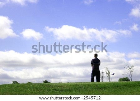 A junior golf champion looks for the green - stock photo