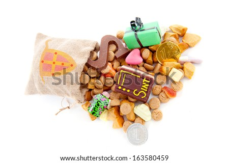 "A jute bag full of pepernoten and other candy, for celebrating a dutch holiday "" Sinterklaas ""  on the fifth of December - stock photo"