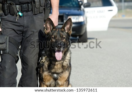 A K9 police officer with his dog. - stock photo