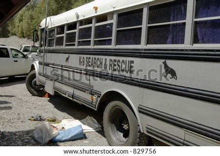 A K-9 search and rescue team on duty in the Rocky Mountains - stock photo