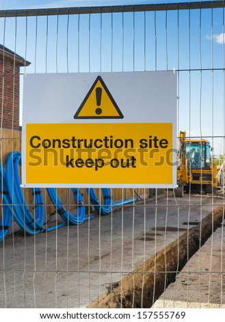 A Keep Out sign, bars entrance to a building site.