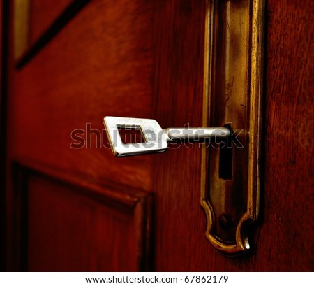 A key in an old door - stock photo