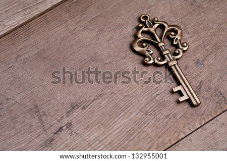 A key on wooden table - stock photo