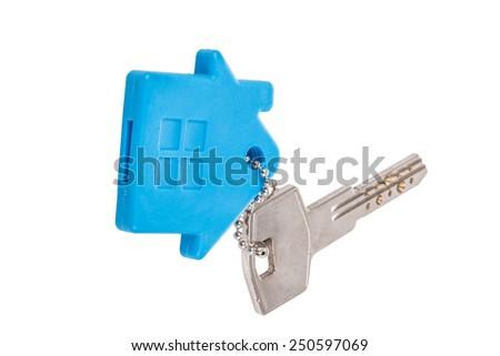 a key with house shaped keyring on white (isolated) - stock photo