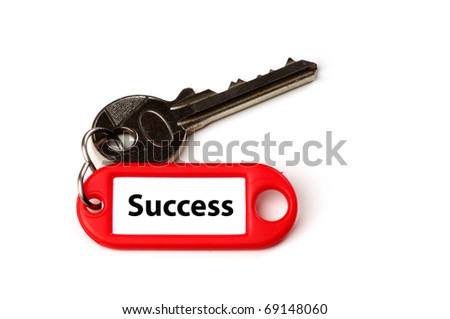 A key with keyring and a label saying success, isolated on white background - stock photo