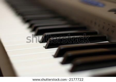 A keyboard of a synthesizer - electronic instrument. Shallow depth of field. - stock photo