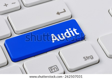 A keyboard with a blue button - Audit - stock photo