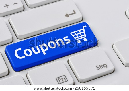 A keyboard with a blue button - Coupons - stock photo