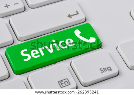 A keyboard with a green button - Service - stock photo