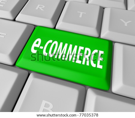 A keyboard with a green key reading e-Commerce, symbolizing the online business of a web-based retailer or other service provider - stock photo