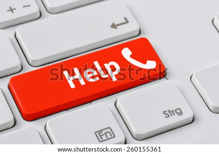 A keyboard with a red button - Help - stock photo