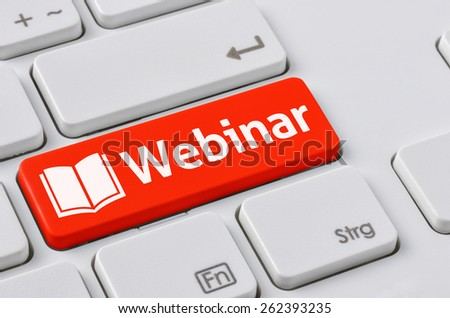 A keyboard with a red button - Webinar - stock photo