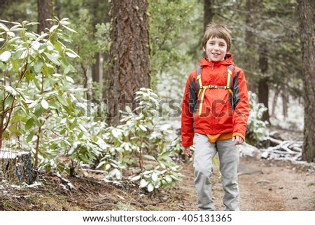 A kid hiking in the snow - stock photo