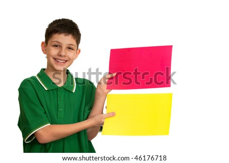 A kid is holding red and yellow sheets of paper in his hands, isolated on the white background