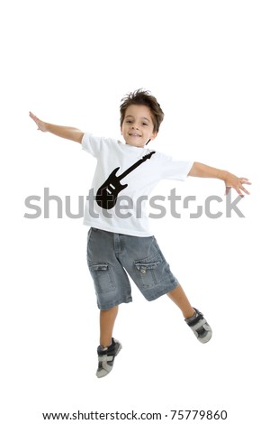 A kid jumping in the air, with a nice tshirt with a guitar painted on it. Isolated on white. - stock photo