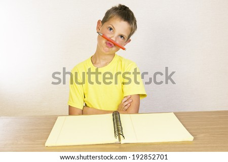 A kid showing his attitude, school boy does not want to learn the lessons - stock photo