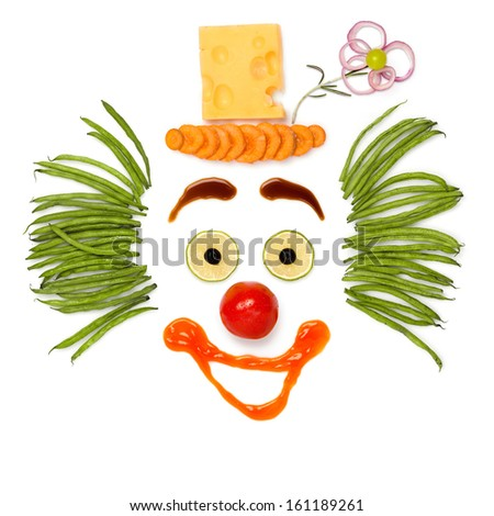 A kind clown made of vegetables and cheese. - stock photo