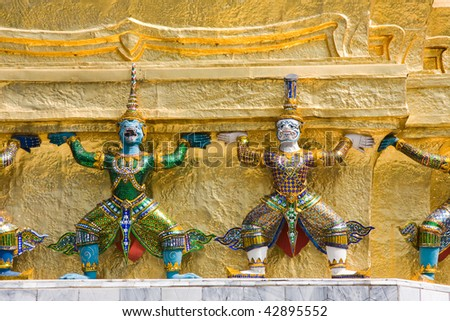A kind of mythological soldier next to a chedi in Grand Palace.Thailand, Bangkok.