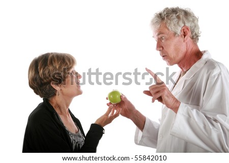 a kindly doctor prescribes an apple to his patient daily - stock photo