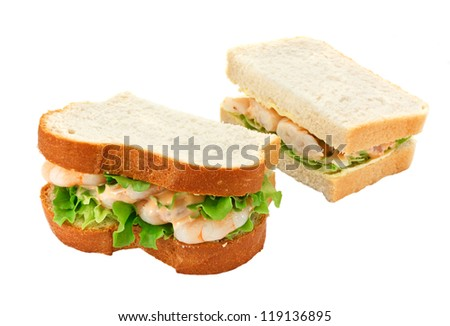 A king prawn salad sandwich with seafood sauce made with freshly sliced bread