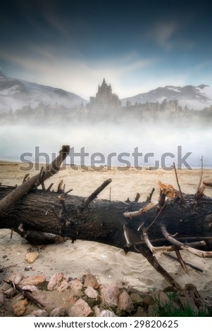 A kingdom a course of ice and snow. A castle into a sea of ice with a tree trunk in the foreground and snowy mountains in background - stock photo
