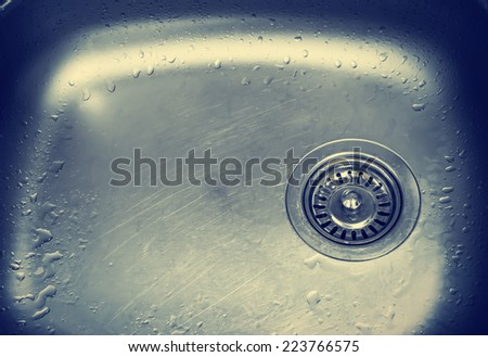 A kitchen sink with water drops - stock photo