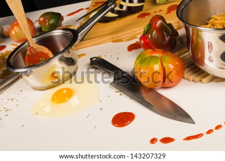 A kitchen table that has become a terrible mess - stock photo