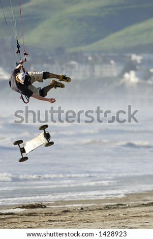 A kite skateboarder, or landboarder, catches extreme air on the California coast.