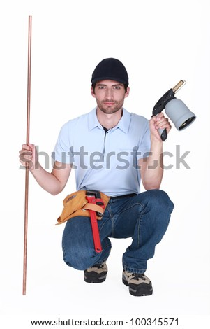 A kneeled welder. - stock photo