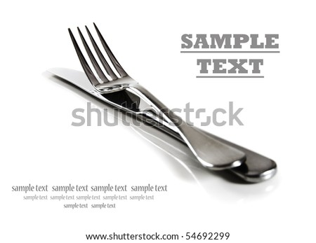 a Knife and fork stacked up on a pure white background with space for text - stock photo