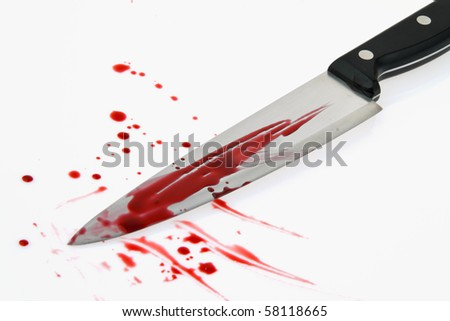 A knife smeared with blood. A murder weapon. Photo icon Crime - stock photo