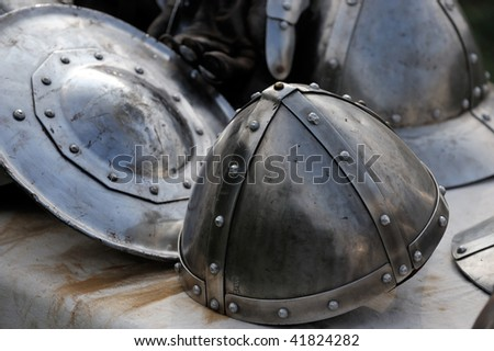 A knight Helmet and Shield in a medieval festival - stock photo