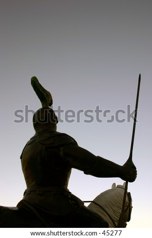 A knight riding a horse and holding a javelin., - stock photo