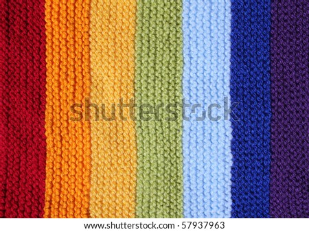 a knitted background in rainbow colors - stock photo