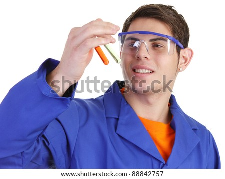 A lab worker looking at test tubes - stock photo