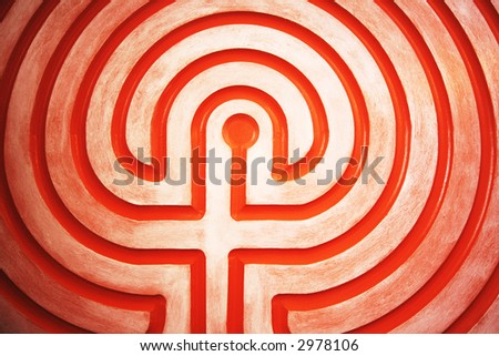 A labyrinth plaque from inside a church - stock photo