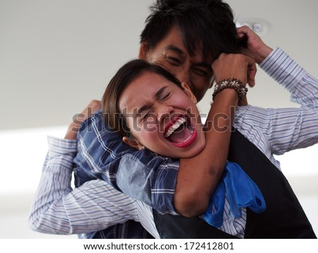A lady being strangled by a man from behind        - stock photo