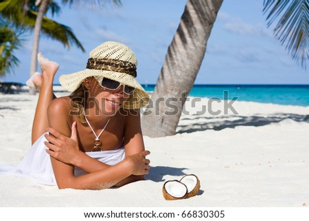 A lady is relax on a tropical beach - stock photo