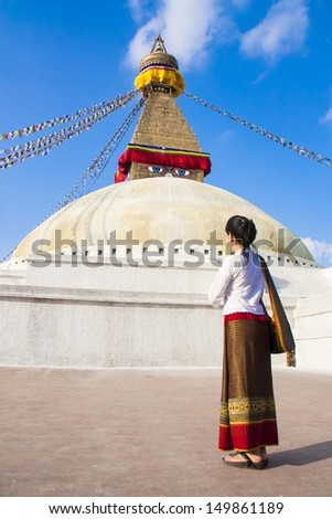 A lady namaste at Nepal Pagoda - stock photo