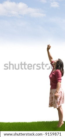 A lady reaching up towards the clouds - stock photo