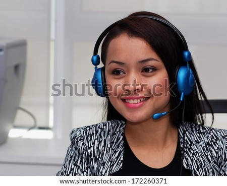A lady with head set and microphone        - stock photo