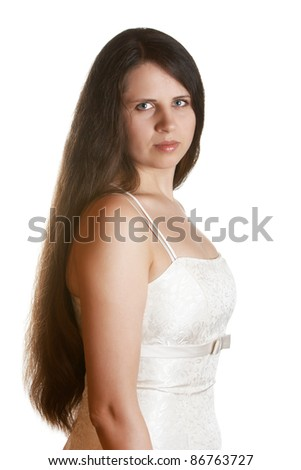 A lady with long hair wearing a white dress