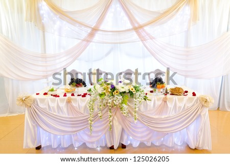 a laid wedding banquet table at a restaurant - stock photo