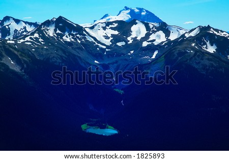 A lake and snow peaks of Blackcomb Mountains. More with keyword group14l  - stock photo